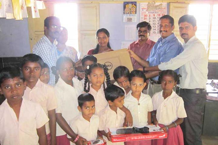 Mr. Biju Pramod handing over computers to Panchayat Union Elementary School
